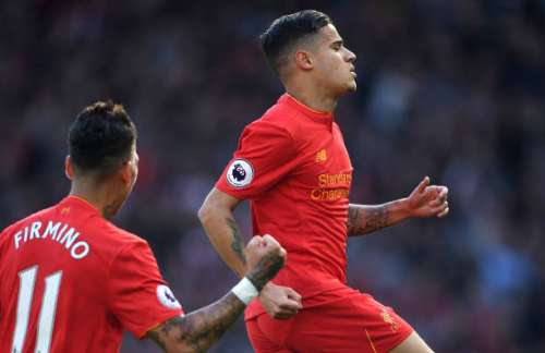 LIVERPOOL, ENGLAND - APRIL 23:  Philippe Coutinho (R) of Liverpool celebrates scoring the opening goal from a free kick during the Premier League match between Liverpool and Crystal Palace at Anfield on April 23, 2017 in Liverpool, England.  (Photo by Laurence Griffiths/Getty Images)
