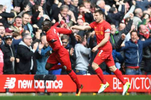 LIVERPOOL, ENGLAND - APRIL 01: Sadio Mane of Liverpool (L) celebrates scoring his sides first goal with James Milner of Liverpool (R) during the Premier League match between Liverpool and Everton at Anfield on April 1, 2017 in Liverpool, England.  (Photo by Gareth Copley/Getty Images)