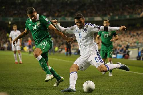 DUBLIN, IRELAND - NOVEMBER 16:  Sead Kolasinac of Bosnia and Herzegovina crosses the ball under pressure from Jon Walters of the Republic of Ireland during the UEFA EURO 2016 Qualifier play off, second leg match between Republic of Ireland and Bosnia and Herzegovina at the Aviva Stadium on November 16, 2015 in Dublin, Ireland.  (Photo by Ian Walton/Getty Images)