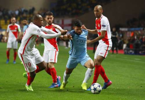 MONACO - MARCH 15:  Sergio Aguero of Manchester City takes on Djibril Sidibe, Bernardo Silva and Fabinho of AS Monaco during the UEFA Champions League Round of 16 second leg match between AS Monaco and Manchester City FC at Stade Louis II on March 15, 2017 in Monaco, Monaco.  (Photo by Michael Steele/Getty Images)