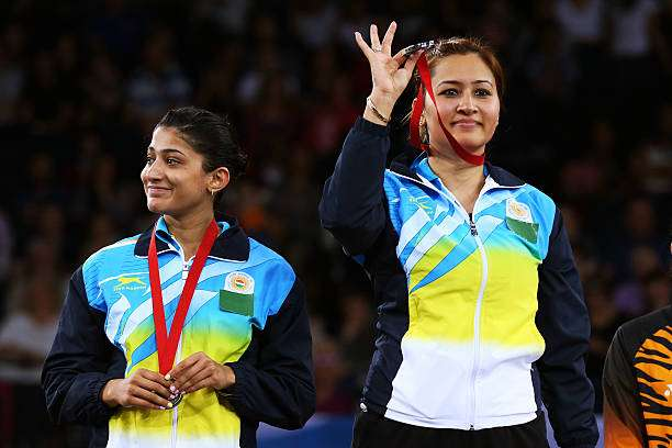 GLASGOW, SCOTLAND - AUGUST 03:  Silver medalists Ashwini Ponnappa and Jwala Gutta of India pose in the medal ceremony for the Women