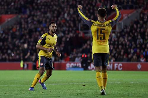 SOUTHAMPTON, ENGLAND - JANUARY 28:  Theo Walcott of Arsenal celebrates after scoring his sides fourth goal with Alex Oxlade-Chamberlain of Arsenal during the Emirates FA Cup Fourth Round match between Southampton and Arsenal at St Mary's Stadium on January 28, 2017 in Southampton, England.  (Photo by Bryn Lennon/Getty Images)