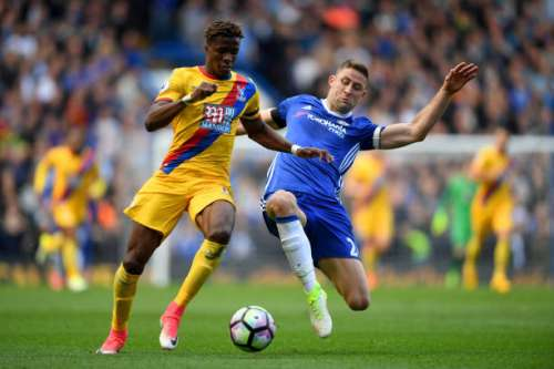 LONDON, ENGLAND - APRIL 01:  Wilfried Zaha of Crystal Palace (L) is tackled by Gary Cahill of Chelsea (R) during the Premier League match between Chelsea and Crystal Palace at Stamford Bridge on April 1, 2017 in London, England.  (Photo by Mike Hewitt/Getty Images)