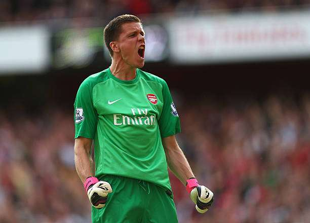 LONDON, ENGLAND - SEPTEMBER 01:  Wojciech Szczesny of Arsenal celebrates after Olivier Giroud of Arsenal (not pictured) scores their first goal during the Barclays Premier League match between Arsenal and Tottenham Hotspur at Emirates Stadium on September 01, 2013 in London, England.  (Photo by Clive Mason/Getty Images)