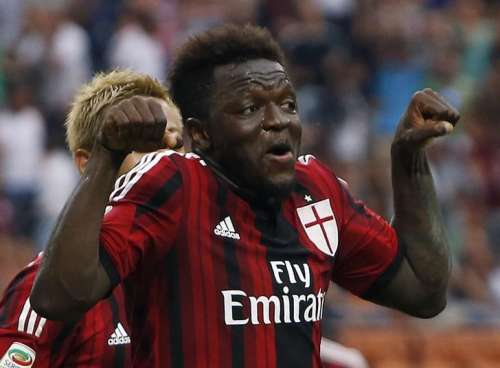 AC Milan's Sulley Muntari celebrates after scoring a goal against Lazio during their Italian Serie A soccer match at the San Siro stadium in Milan August 31, 2014. REUTERS/Alessandro Garofalo/Files