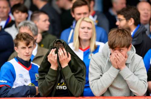 BRENTFORD, ENGLAND - MAY 07:   Blackburn Rovers fans look dejected after being relegated after the Sky Bet Championship match between Brentford and Blackburn Rovers at Griffin Park on May 7, 2017 in Brentford, England. (Photo by Justin Setterfield/Getty Images)