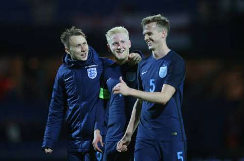 RANDERS, DENMARK - MARCH 27:  (L-R) Cauley Woodrow, Will Hughes and Rob Holding of England smile after victory in the U21 international friendly match between Denmark and England at BioNutria Park on March 27, 2017 in Randers, Denmark.  (Photo by Steve Bardens/Getty Images)
