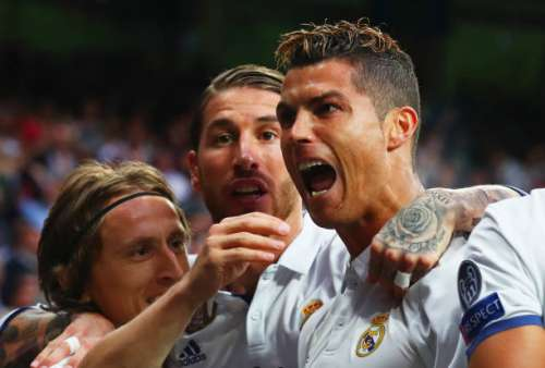 MADRID, SPAIN - MAY 02:  Cristiano Ronaldo of Real Madrid (R) celebrates as he scores their first goal with team mates Luka Modric and Sergio Ramos during the UEFA Champions League semi final first leg match between Real Madrid CF and Club Atletico de Madrid at Estadio Santiago Bernabeu on May 2, 2017 in Madrid, Spain.  (Photo by Clive Rose/Getty Images)