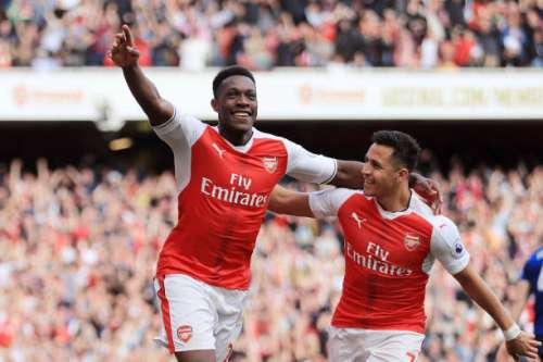 LONDON, ENGLAND - MAY 07:  Danny Welbeck of Arsenal celebrates scoring his sides second goal with Alexis Sanchez of Arsenal during the Premier League match between Arsenal and Manchester United at the Emirates Stadium on May 7, 2017 in London, England.  (Photo by Richard Heathcote/Getty Images)