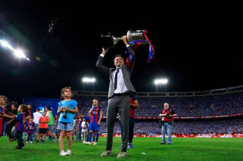 MADRID, SPAIN - MAY 27:  Head coach Luis Enrique Martinez of FC Barcelona team stands the King's Cup after winning the Copa Del Rey Final between FC Barcelona and Deportivo Alaves at Vicente Calderon Stadium on May 27, 2017 in Madrid, Spain.  (Photo by Gonzalo Arroyo Moreno/Getty Images)
