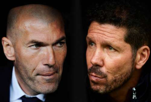 FILE PHOTO (EDITORS NOTE: COMPOSITE OF TWO IMAGES - Image numbers (L) 516743572 and 617499668) In this composite image a comparision has been made between Real Madrid Head Coach Zinedine Zidane (L) and Head coach of Club Atletico de Madrid Diego Simeone.  Real Madrid CF and Club Atletico de Madrid meet in one of the UEFA Champions League Semi Finals.  ***LEFT IMAGE*** MADRID, SPAIN - MARCH 20: Real Madrid Head Coach Zinedine Zidane looks on before the start of the La Liga match between Real Madrid CF and Sevilla FC at Estadio Santiago Bernabeu on March 20, 2016 in Madrid, Spain. (Photo by Denis Doyle/Getty Images) ***RIGHT IMAGE*** SEVILLE, SPAIN - OCTOBER 23: Head coach of Club Atletico de Madrid Diego Simeone looks on during the match between Sevilla FC vs Club Atletico de Madrid as part of La Liga at Estadio Ramon Sanchez Pizjuanon October 23, 2016 in Seville, Spain. (Photo by Aitor Alcalde/Getty Images)