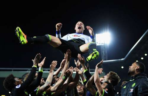 WEST BROMWICH, ENGLAND - MAY 12:  John Terry of Chelsea is chucked in the air by team mates while celebrating winning the leauge title after the Premier League match between West Bromwich Albion and Chelsea at The Hawthorns on May 12, 2017 in West Bromwich, England.  (Photo by Laurence Griffiths/Getty Images)