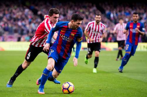 BARCELONA, SPAIN - FEBRUARY 04: Lionel Messi of FC Barcelona runs with the ball next to Aymeric Laporte of Athletic Club during the La Liga match between FC Barcelona and Athletic Club at Camp Nou  stadium on February 4, 2017 in Barcelona, Spain. (Photo by Alex Caparros/Getty Images)