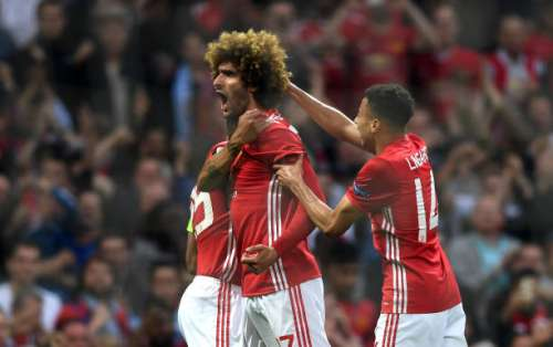 MANCHESTER, ENGLAND - MAY 11:  Marouane Fellaini of Manchester United celebrates scoring his sides first goal with team mates during the UEFA Europa League, semi final second leg match, between Manchester United and Celta Vigo at Old Trafford on May 11, 2017 in Manchester, United Kingdom.  (Photo by Gareth Copley/Getty Images)