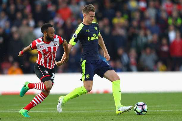 SOUTHAMPTON, ENGLAND - MAY 10:  Nathan Redmond of Southampton closes down Rob Holding of Arsenal during the Premier League match between Southampton and Arsenal at St Mary