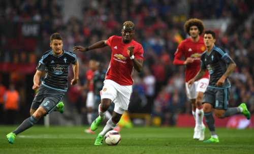 MANCHESTER, ENGLAND - MAY 11:  Paul Pogba of Manchester United is chased  by Nemanja Radoja of Celta Vigo   during the UEFA Europa League, semi final second leg match, between Manchester United and Celta Vigo at Old Trafford on May 11, 2017 in Manchester, United Kingdom.  (Photo by Gareth Copley/Getty Images)