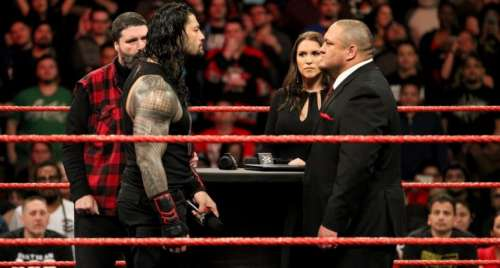 Roman Reigns and Samoa Joe in the ring on RAW