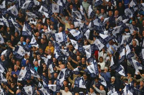 LONDON, ENGLAND - MAY 14:  Tottenham Hotspur fans wave their flags during the closing ceremony after the Premier League match between Tottenham Hotspur and Manchester United at White Hart Lane on May 14, 2017 in London, England. Tottenham Hotspur are playing their last ever home match at White Hart Lane after their 112 year stay at the stadium. Spurs will play at Wembley Stadium next season with a move to a newly built stadium for the 2018-19 campaign.  (Photo by Clive Rose/Getty Images)