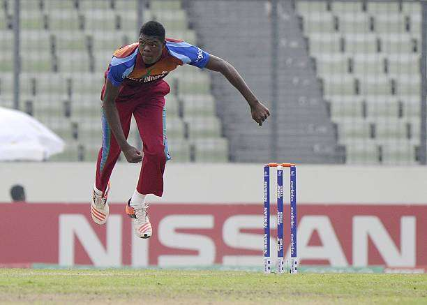 DHAKA, BANGLADESH - FEBRUARY 14: Alzarri Joseph of West Indies U19 bowls during the ICC U19 World Cup Final Match between India and West Indies on February 14, 2016 in Dhaka, Bangladesh.  (Photo by Pal Pillai/Getty Images for Nissan)
