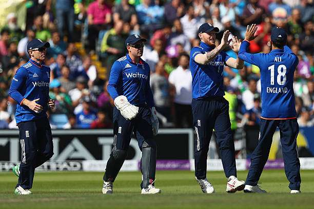 LEEDS, ENGLAND - SEPTEMBER 01:  Ben Stokes (2R)  of England celebrates with Moeen Ali (R) after taking a catch off the bowling of Chris Jordan to dismiss Sharjeel Khan of Pakistan during the 4th Royal London One -Day International match between England and Pakistan at Headingley on September 1, 2016 in Leeds, England.  (Photo by Michael Steele/Getty Images)