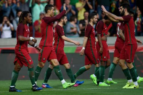FUNCHAL, MADEIRA, PORTUGAL - MARCH 28: Cristiano Ronaldo of Portugal celebrates with team mates after scoring the first goal against Sweden during the International friendly match between Portugal and Sweden at Barreiros stadium on March 28, 2017 in Funchal, Madeira, Portugal. (Photo by Octavio Passos/Getty Images)