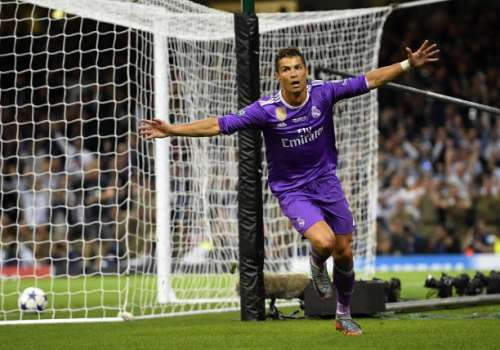 CARDIFF, WALES - JUNE 03:  Cristiano Ronaldo of Real Madrid celebrates with his winners medal after victory in the UEFA Champions League Final between Juventus and Real Madrid at National Stadium of Wales on June 3, 2017 in Cardiff, Wales.  (Photo by Laurence Griffiths/Getty Images)