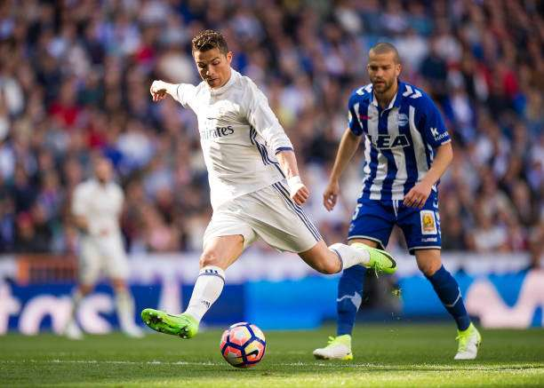 MADRID, SPAIN - APRIL 02:  Cristiano Ronaldo of Real Madrid has a shot at goal during the La Liga match between Real Madrid CF and Deportivo Alaves on April 2, 2017 in Madrid, Spain.  (Photo by Denis Doyle/Getty Images)