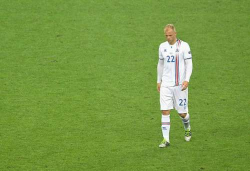 PARIS, FRANCE - JULY 03: Eidur Gudjohnsen of Iceland leaves the pitch after his team's 2-5 defeat in the UEFA EURO 2016 quarter final match between France and Iceland at Stade de France on July 3, 2016 in Paris, France.  (Photo by Michael Regan/Getty Images)