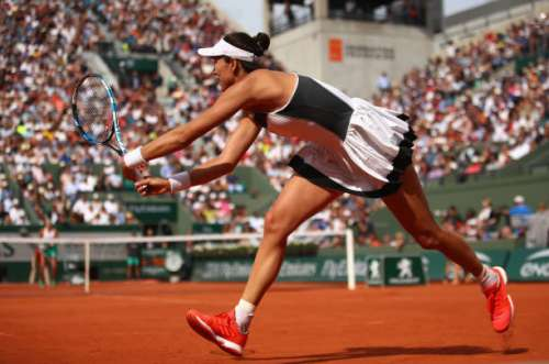 PARIS, FRANCE - JUNE 04:  Garbine Muguruza of Spain plays a backhand during the ladies singles fourth round match against Kristina Mladenovic of France on day eight of the 2017 French Open at Roland Garros on June 4, 2017 in Paris, France.  (Photo by Clive Brunskill/Getty Images)