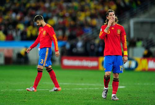 DURBAN, SOUTH AFRICA - JUNE 16: Gerard Pique and Sergio Ramos of Spain look dejected during the 2010 FIFA World Cup South Africa Group H match between Spain and Switzerland at Durban Stadium on June 16, 2010 in Durban, South Africa.  (Photo by Jamie McDonald/Getty Images)