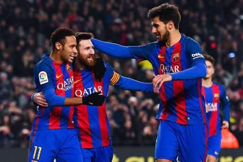 BARCELONA, SPAIN - JANUARY 26:  Lionel Messi (C) of FC Barcelona celebrates with his team mates Neymar Jr. (L) and Andre Gomes after scoring from the penalty spot his team's second goal during the Copa del Rey quarter-final second leg match between FC Barcelona and Real Sociedad at Camp Nou on January 26, 2017 in Barcelona, Spain.  (Photo by David Ramos/Getty Images)