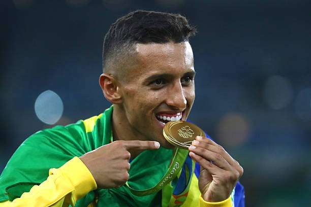 RIO DE JANEIRO, BRAZIL - AUGUST 20:  Marquinhos of Brazil celebrates with his gold medal following the Men