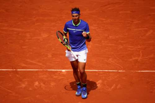 PARIS, FRANCE - JUNE 04:  Rafael Nadal of Spain celebrates victory during the mens singles fourth round match against Roberto Bautista Agut of Spain on day eight of the 2017 French Open at Roland Garros on June 4, 2017 in Paris, France.  (Photo by Clive Brunskill/Getty Images)