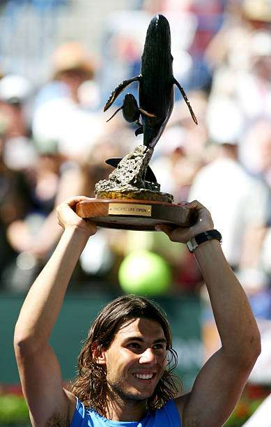 INDIAN WELLS, CA - MARCH 18:  Rafael Nadal of Spain holds up the championship trophy after defeating Novak Djokovic of Serbia in the final of the Pacific Life Open on March 18, 2007 at the Indian Wells Tennis Garden in Indian Wells, California.  Nadal defeated Djokovic 6-2, 7-5.  (Photo by Harry How/Getty Images)