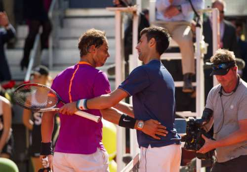 MADRID, SPAIN - MAY 13:  Rafael Nadal of Spain is congratulated by Novak Djokovic of Serbia after winning the semi-finals match during day eight of the Mutua Madrid Open tennis at La Caja Magica on May 13, 2017 in Madrid, Spain.  (Photo by Denis Doyle/Getty Images)