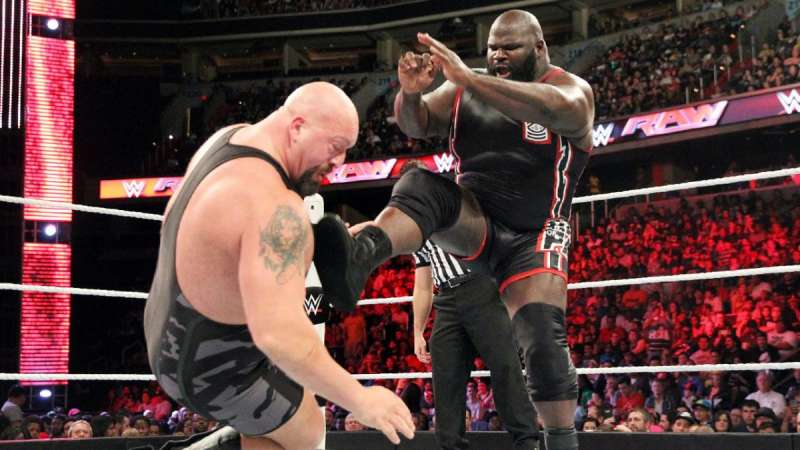 Big Show taking a boot from Mark Henry.
