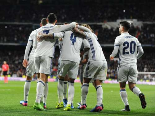 MADRID, SPAIN - MARCH 12:  Sergio Ramos of Real Madrid celebrates with Cristiano Roanldo and Luka Mordic after scoring Real's 2nd goal during the La Liga match between Real Madrid CF and Real Betis Balompie at Estadio Santiago Bernabeu on March 12, 2017 in Madrid, Spain.  (Photo by Denis Doyle/Getty Images)