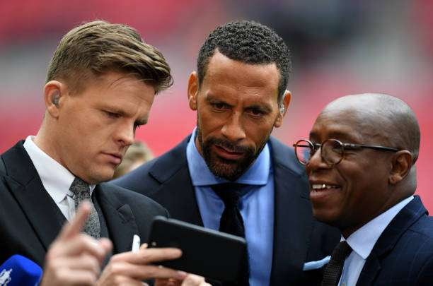 LONDON, ENGLAND - APRIL 23:  BT Sport presenter Jake Humphrey (L) and pundits Rio Ferdinand and Ian Wright look at a smartphone prior to the Emirates FA Cup Semi-Final match between Arsenal and Manchester City at Wembley Stadium on April 23, 2017 in London, England.  (Photo by Shaun Botterill/Getty Images,)