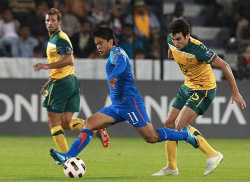 DOHA, QATAR - JANUARY 10: Sunil Chhetri of India gets the ball away from Mile Jedinak of Australia during the AFC Asian Cup Group C match between India and Australia at Al-Sadd Stadium on January 10, 2011 in Doha, Qatar.  (Photo by Robert Cianflone/Getty Images)