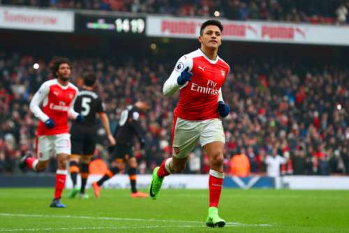 LONDON, ENGLAND - FEBRUARY 11:  Alexis Sanchez of Arsenal celebrates scoring his side's second goal from the penalty spot during the Premier League match between Arsenal and Hull City at Emirates Stadium on February 11, 2017 in London, England.  (Photo by Clive Rose/Getty Images)