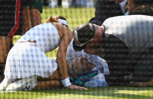 LONDON, ENGLAND - JULY 06:  Bethanie Mattek-Sands of The United States receives treatment from the medical team and later retires from the Ladies Singles second round match against Sorana Cirstea of Romania on day four of the Wimbledon Lawn Tennis Championships at the All England Lawn Tennis and Croquet Club on July 6, 2017 in London, England.  (Photo by David Ramos/Getty Images)