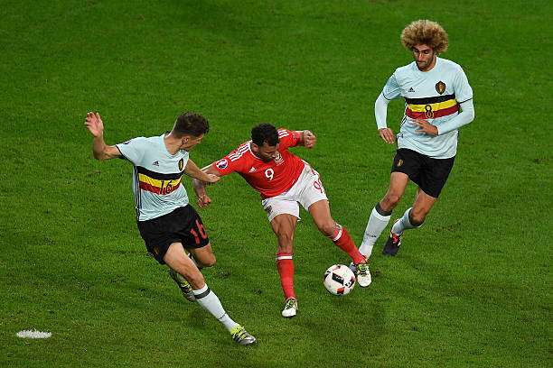LILLE, FRANCE - JULY 01:  Hal Robson-Kanu of Wales turns Thomas Meunier and Marouane Fellaini of Belgium inside out as he scores his team