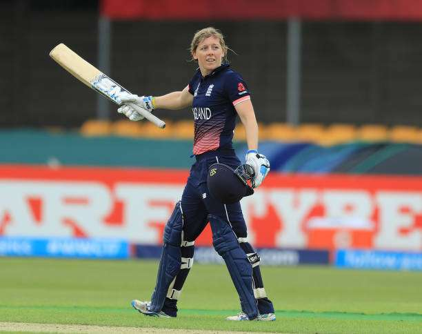 LEICESTER, ENGLAND - JUNE 27:  Heather Knight of England celebrates reaching her century during the Women