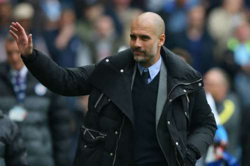 MANCHESTER, ENGLAND - MAY 13: Josep Guardiola, Manager of Manchester City shows appreciation to the fans as he walks to the bench prior to the Premier League match between Manchester City and Leicester City at Etihad Stadium on May 13, 2017 in Manchester, England.  (Photo by Alex Livesey/Getty Images)