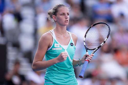 SYDNEY, AUSTRALIA - JANUARY 15:  Karolina Pliskova of Czech Republic celebrates after winning a point in her semi final match against Angelque Kerber of German during day five of the Sydney International at Sydney Olympic Park Tennis Centre on January 15, 2015 in Sydney, Australia.  (Photo by Brett Hemmings/Getty Images)