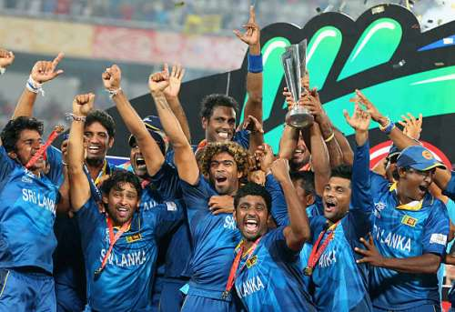 DHAKA, BANGLADESH - APRIL 06:  Lasith Malinga of Sri Lanka and his team celebrate with the trophy on the podium after winning the Final of the ICC World Twenty20 Bangladesh 2014 between India and Sri Lanka at Sher-e-Bangla Mirpur Stadium on April 4, 2014 in Dhaka, Bangladesh.  (Photo by Scott Barbour/Getty Images)