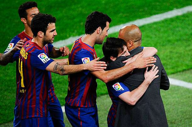 BARCELONA, SPAIN - MAY 05:  Lionel Messi of FC Barcelona (2ndL) hugs his Head coach Josep Guardiola of FC Barcelona after scoring his team