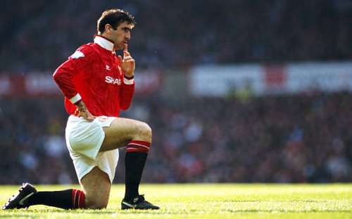 MANCHESTER, UNITED KINGDOM - APRIL 23: Manchester United striker Eric Cantona reacts during an FA Premier League match between Manchester United and Manchester City at Old Trafford on April 23, 1993 in Manchester, England, United won the game 2-0 with both goals scored by Cantona.  (Photo by Anton Want/Allsport/Getty Images)