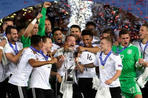 KRAKOW, POLAND - JUNE 30:  Maximilian Arnold of Germany lifts the trophy with his Germany team mates after the UEFA European Under-21 Championship Final between Germany and Spain at Krakow Stadium on June 30, 2017 in Krakow, Poland.  (Photo by Nils Petter Nilsson/Ombrello/Getty Images)