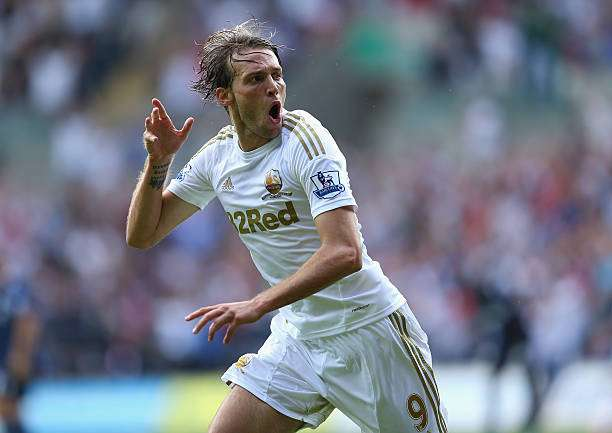 SWANSEA, WALES - AUGUST 25:  Michu of Swansea celebrates scoring the second goal during the Barclays Premier League match between Swansea City and West Ham United at the Liberty Stadium on August 25, 2012 in Swansea, Wales.  (Photo by Richard Heathcote/Getty Images)